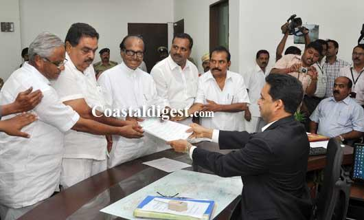 Poojary files nomination, says it's a straight fight between Cong and BJP in DK