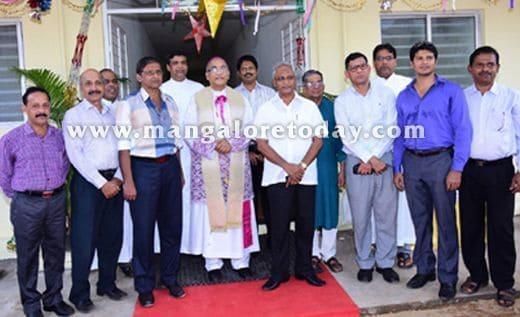 Bishop hands over 24 houses to needy