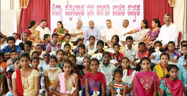 Kundar family donates school books and scholarships to 150 students