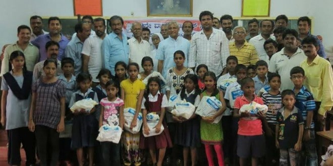 Mangaluru: 40th Block Congress distributes notebooks to 150 poor students